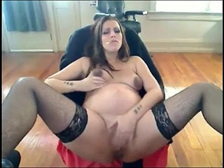 Smoking pregnant woman talks dirty and masturbates