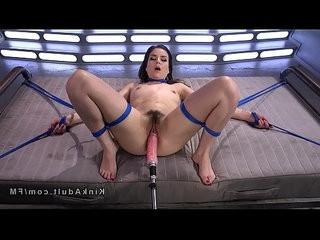 Hairy babe in ropes fucking machine