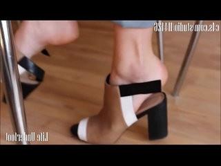 candid dangles her heels under the desk