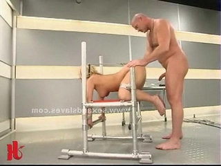 Blond sex slave tied on bondage devices