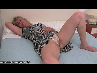 Granny with hard nipples finger fucks her old pussy